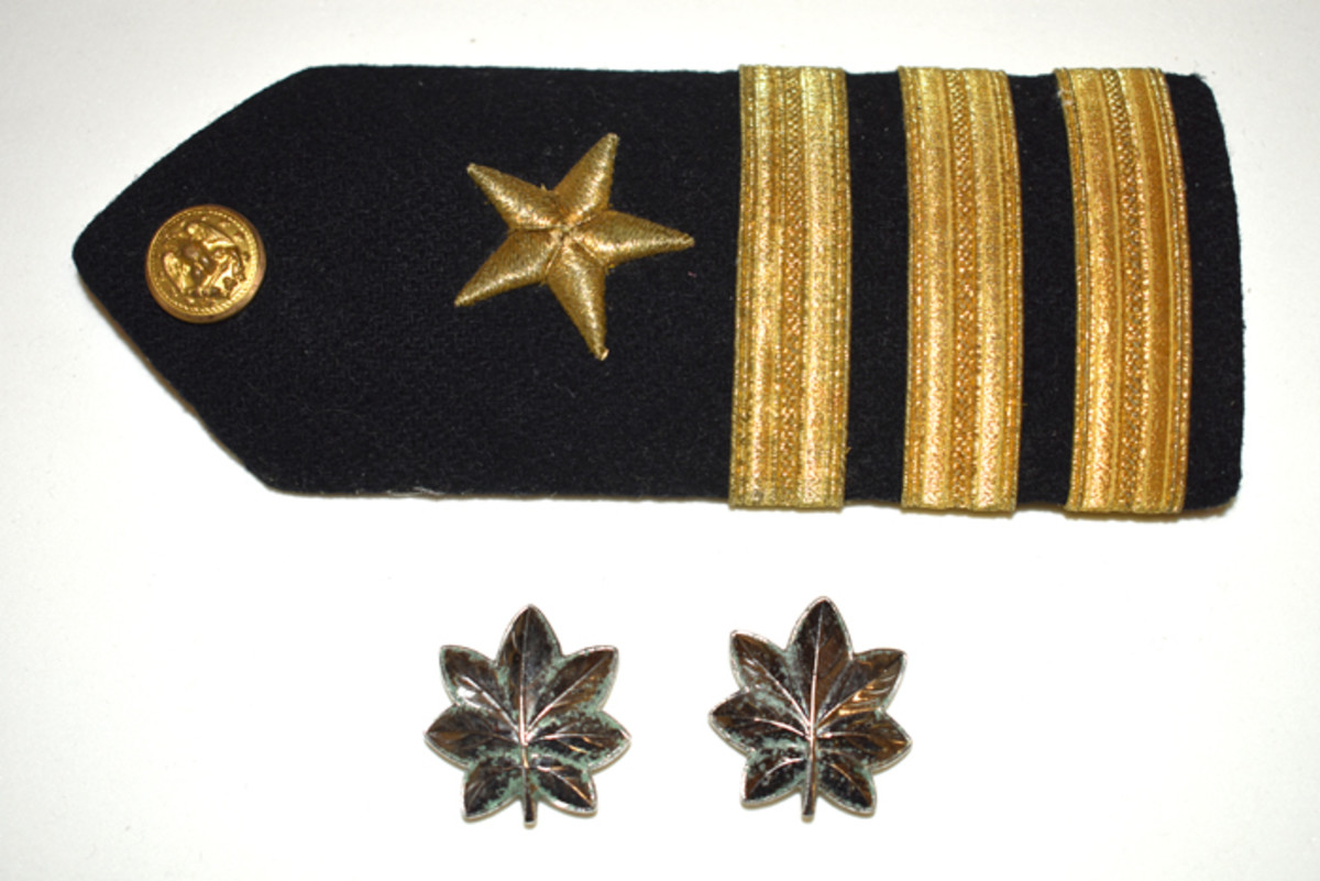 Buell's epaulet and collar pins indicated his rank as Commander both at Sea and at West Point.