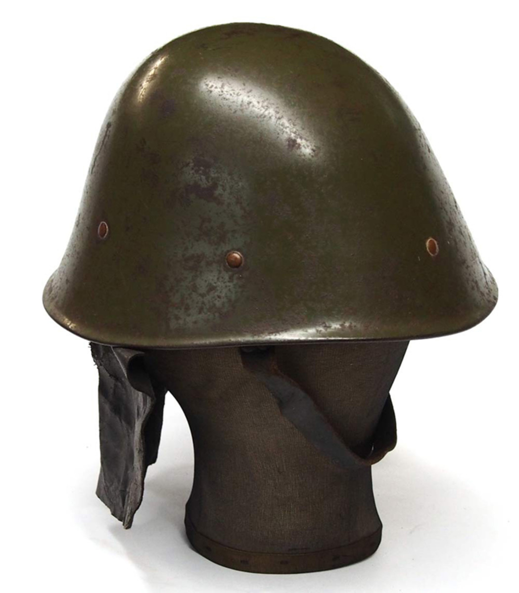 The profile of the steel helmet shows how the leather neck curtain shielded the wearer's neck — even though leather seemed a poor choice of materials to use in tropical conditions!