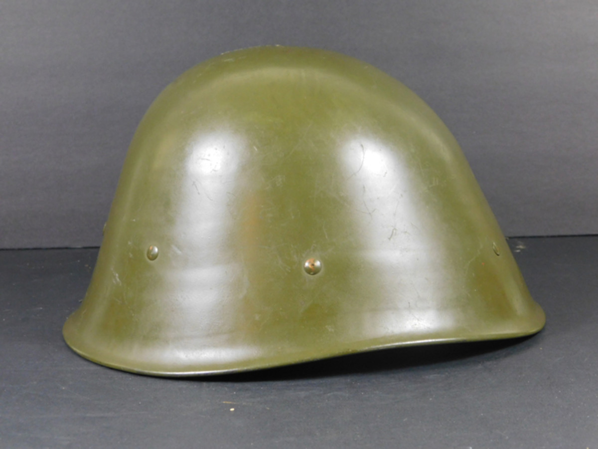 The KNIL helmets were painted green and had a profile similar to those combat helmets used by the Dutch Army in the Netherlands.