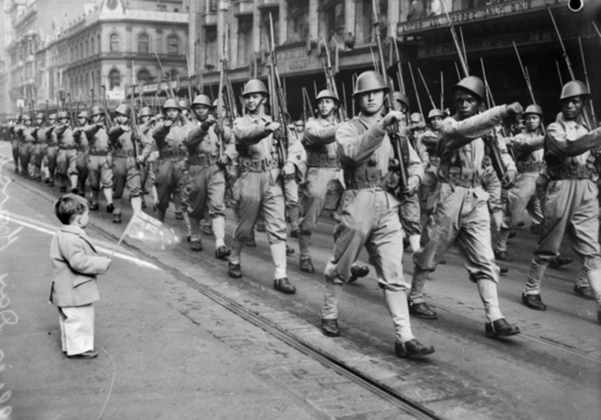 The use of a steel helmet in the tropics might seem odd, but The Dutch Ministry of Colonial Affairs ordered 45,000 specially designed steel helmets to issue to the Royal Netherlands East Indies Army (Koninklijk Nederlands Indisch Leger — KNIL).These KNIL soldiers are seen marching through Melbourne, Australia, in late 1942. They were fortunate enough to escape from the Dutch East Indies and were apparently resupplied with American boots and web gear in addition to the steel tropical helmets. The KNIL was made up of European as well as native troops. These men fought side-by-side throughout the war.