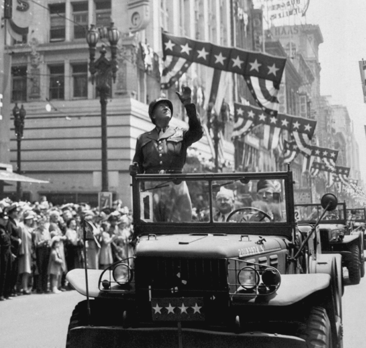 General George S. Patton acknowledging the cheers of the welcoming crowds in Los Angeles, CA, during his visit on June 9, 1945, standing in his command car.