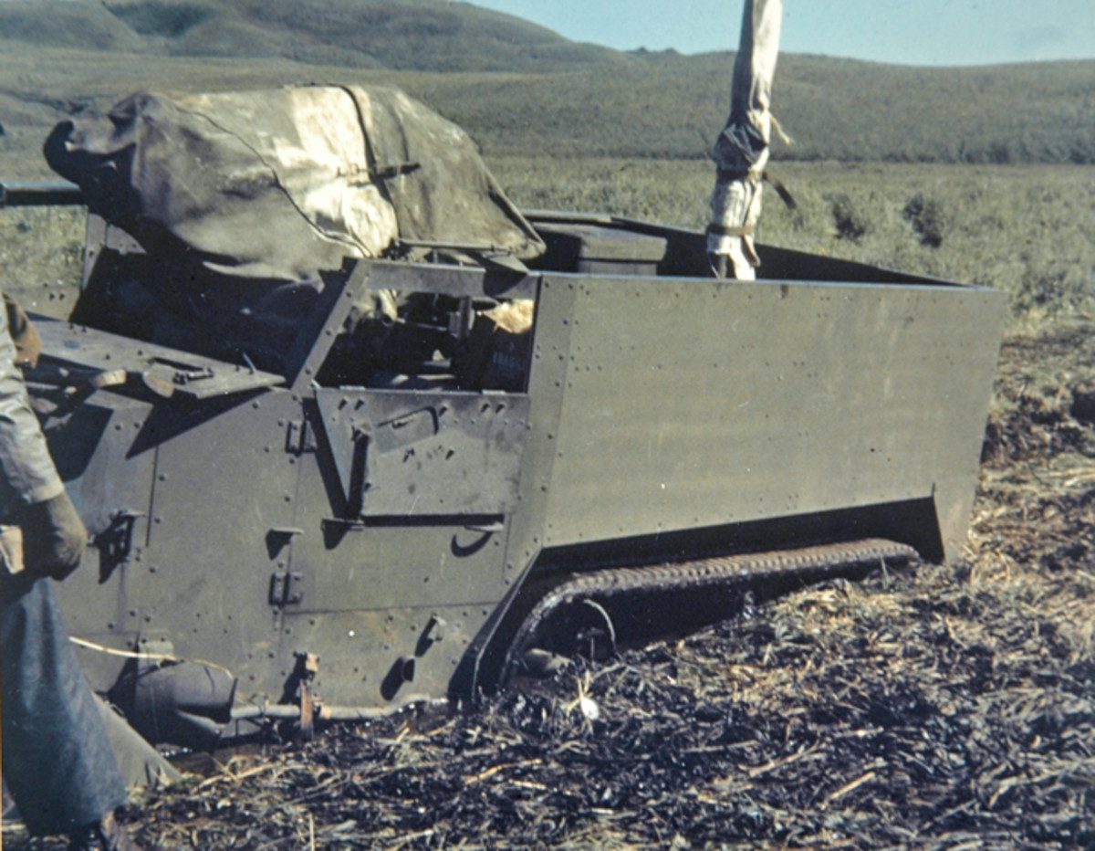 M3A1 half-track stuck in the mud in the Aleutans.