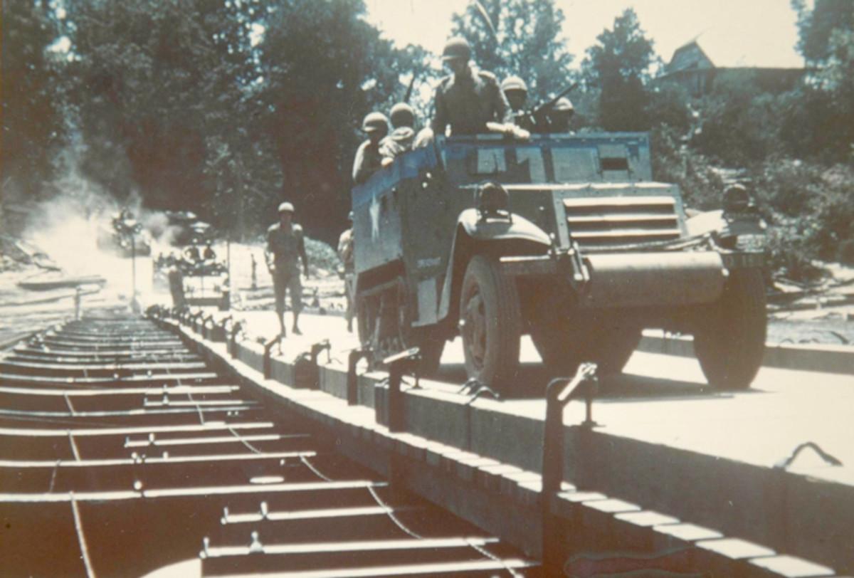 This M2 half-track is crossing a a pontoon bridge.