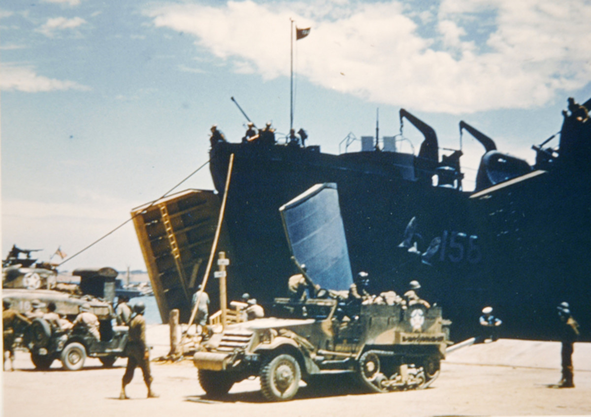 This M2 half-track is being backed onto an LST in preparation of the invasion of Sicily.