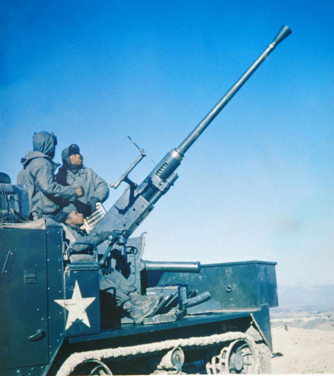 The M34 40mm gun motor carriage was created during the Korean War by rearming M15A1 multiple gun motor carriages with a 40mm Bofors cannon instead of the previously used 37mm cannon and twin .50 caliber machine guns.