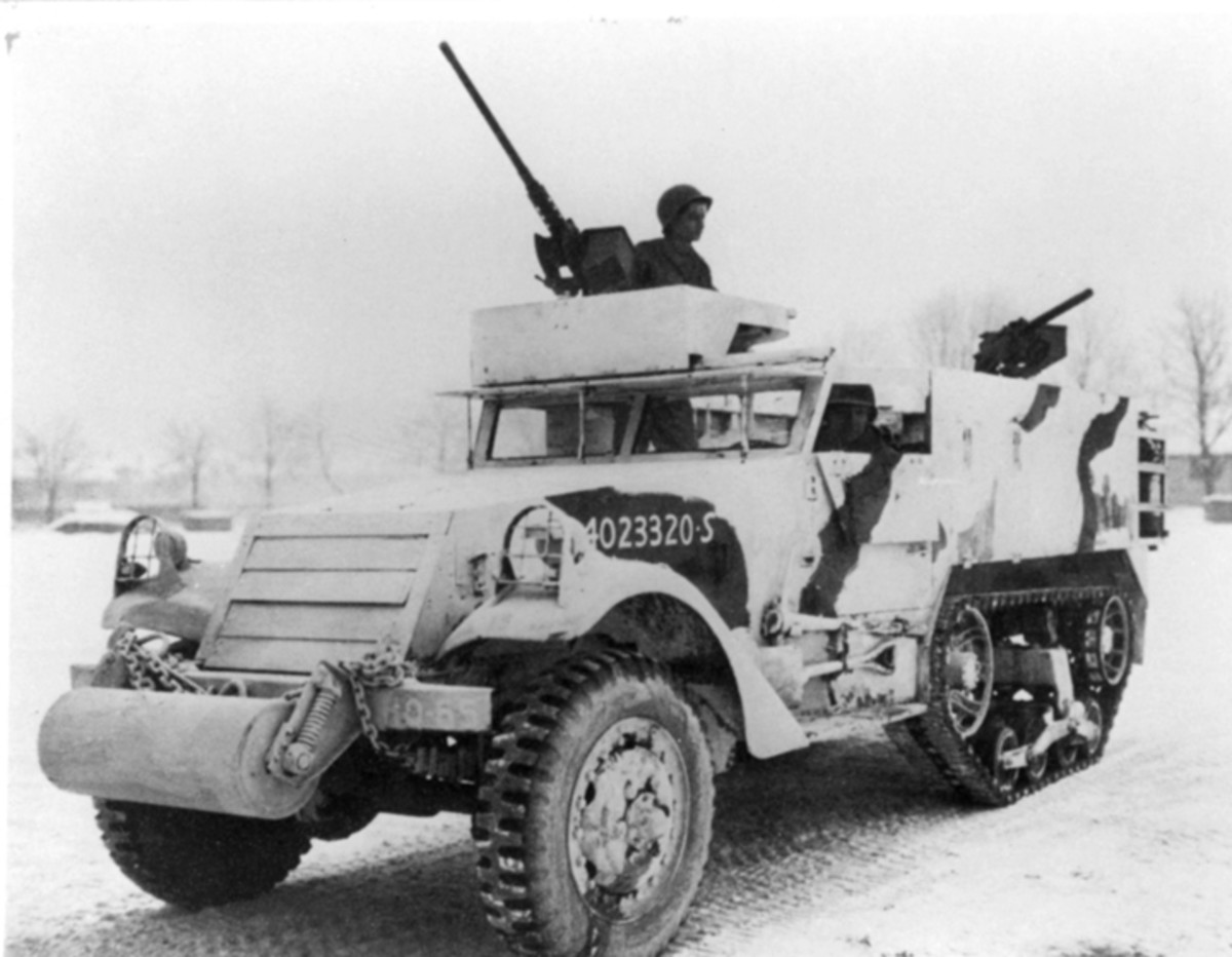 This M2A1 wearing winter camouflage was operating near Bastogne, Belgium.