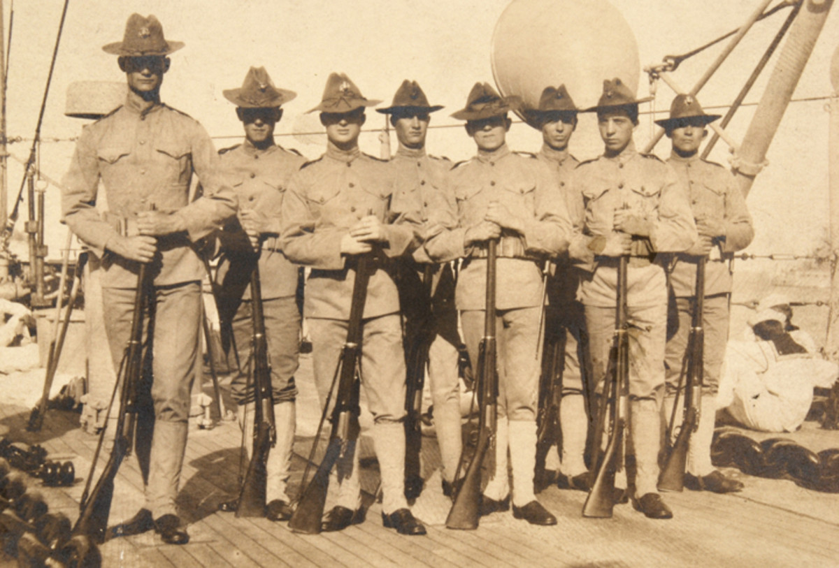 These shipboard Marines are wearing the predecessor to the P1912 hat, the fore-to-aft creased Pattern or 1898 hat.