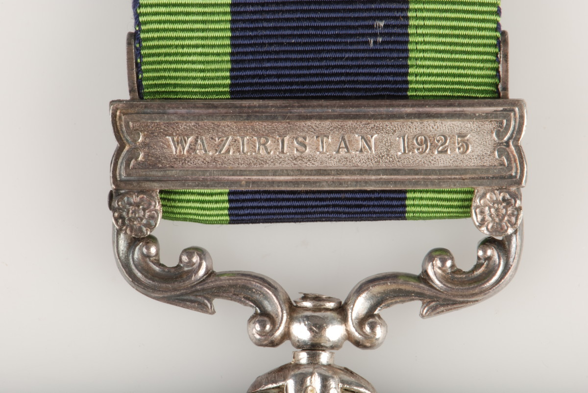 "The India General Service Medal was presented with the ""Waziristan 1925"" riveted to the planchet's suspension bar"
