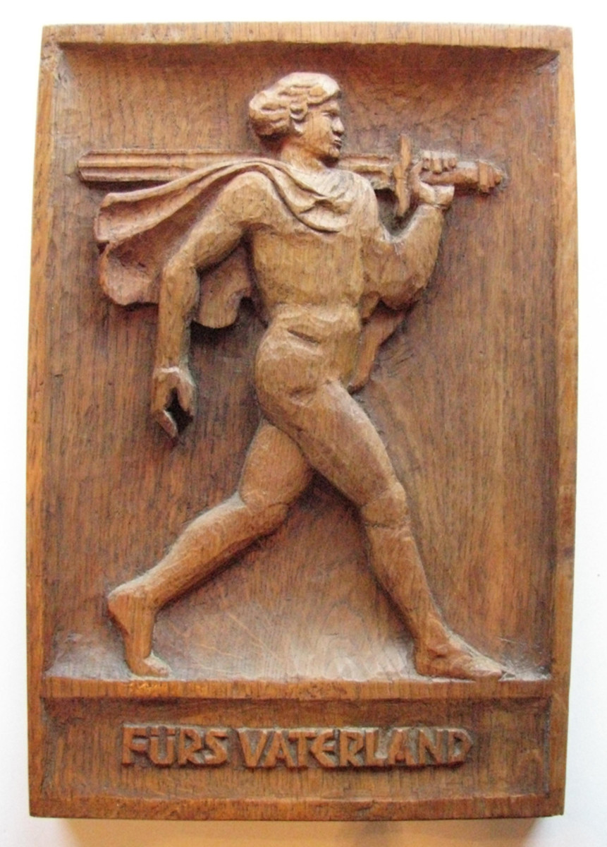 """A sword carrying ideal Aryan strides above """"Für Vaterland"""" (For the Fatherland) on this patriotic wall plate."""