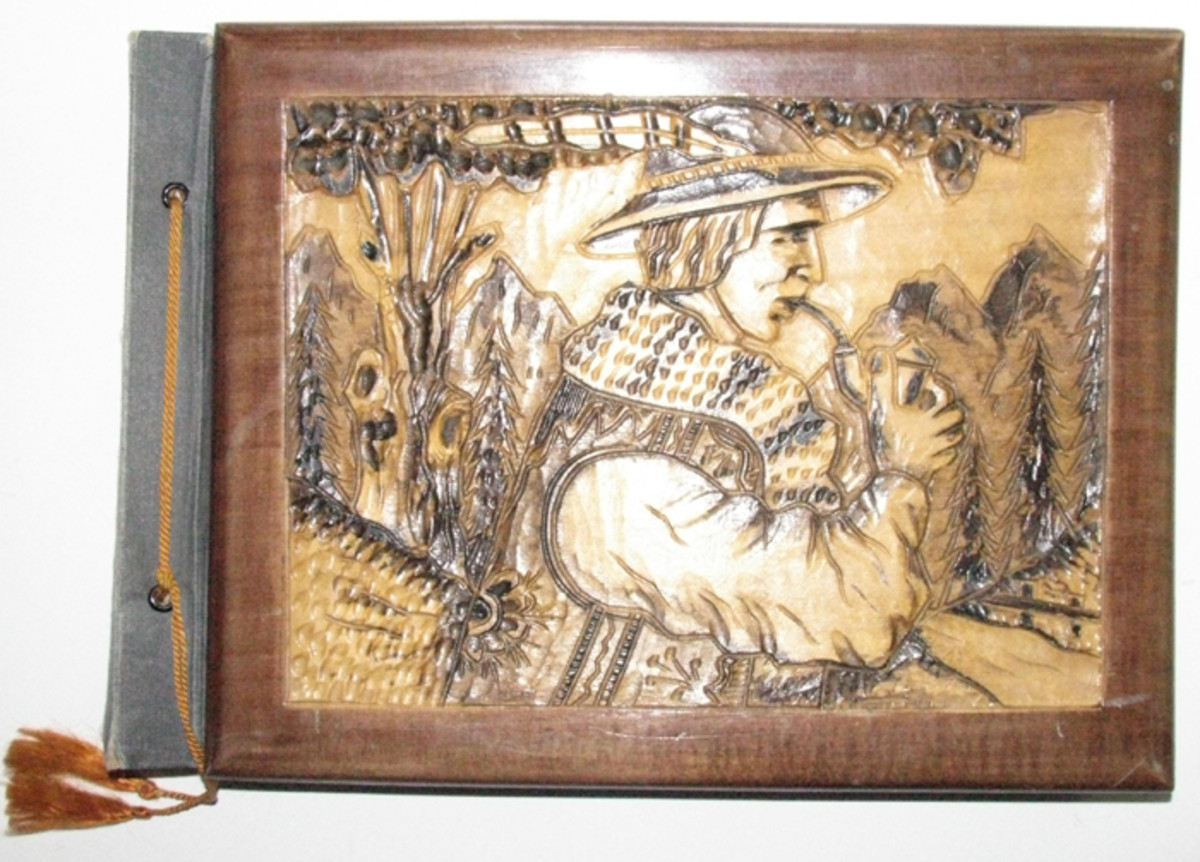 An artfully carved farmer with his pipe covers the photo album of a soldier who participated in the Polish invasion of 1939.