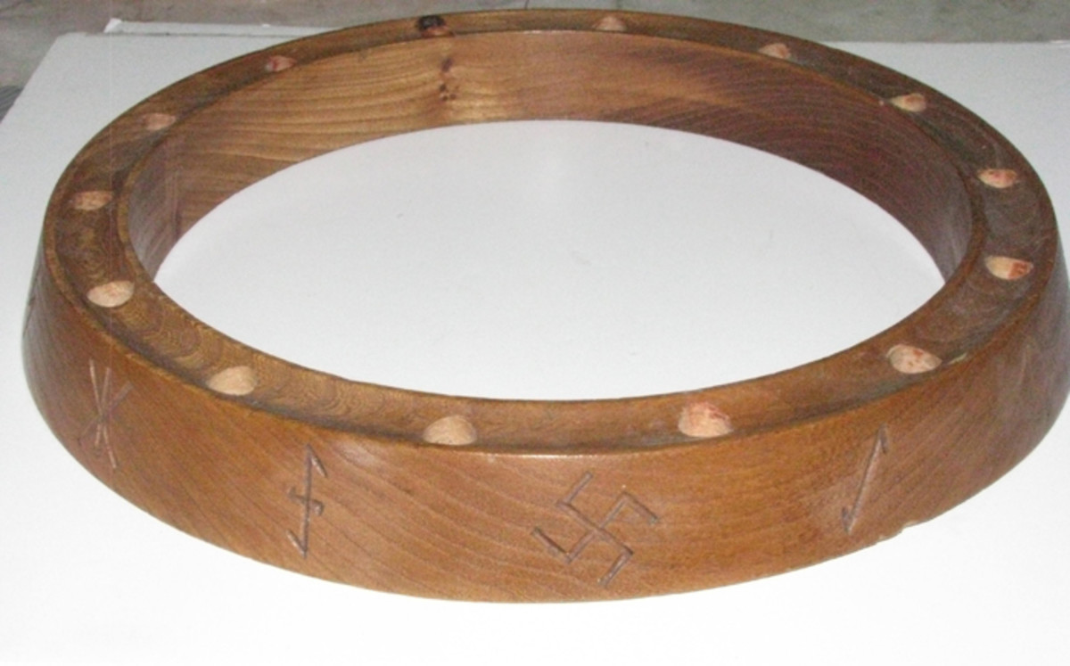 A prominently displayed SS birthday celebration wooden ring for a child. Each birthday, a progressive number of candles were placed in the holes until his 14th year, at which time the child would join the Hitler Youth.