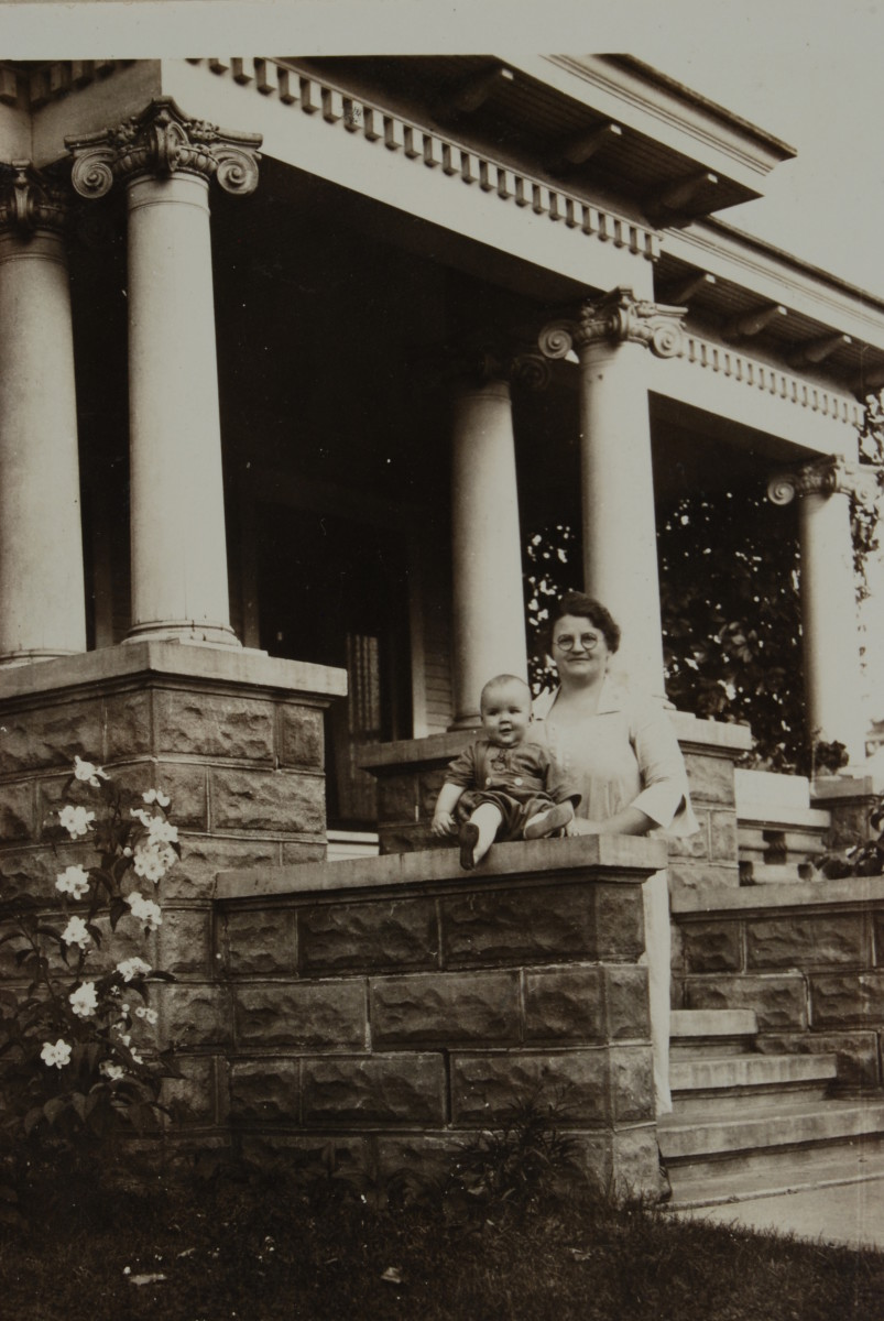 John Milton Graf and his mother, Magdalena, on the front porch of the old house, ca. 1921.