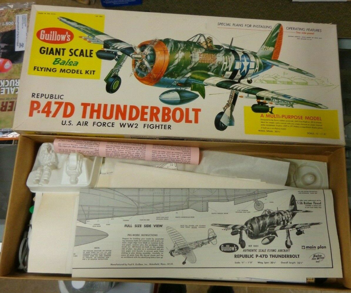 Balsa kit of unassembled P-47 Thunderbolt airplane.