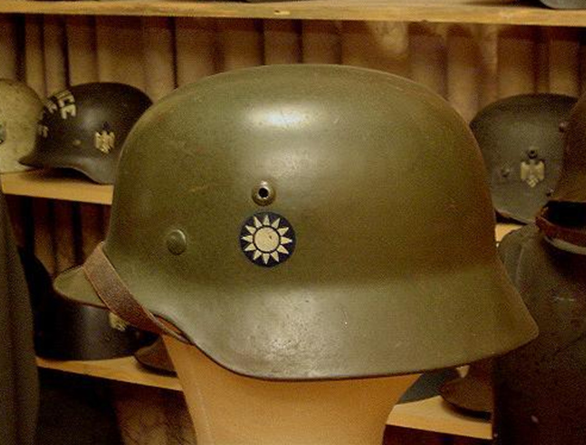 This German M-35 helmet features the distinct insignia of the Nationalist Chinese forces. Along with helmets, the Germans supplied a variety of equipment to the Chinese including Mauser rifles.