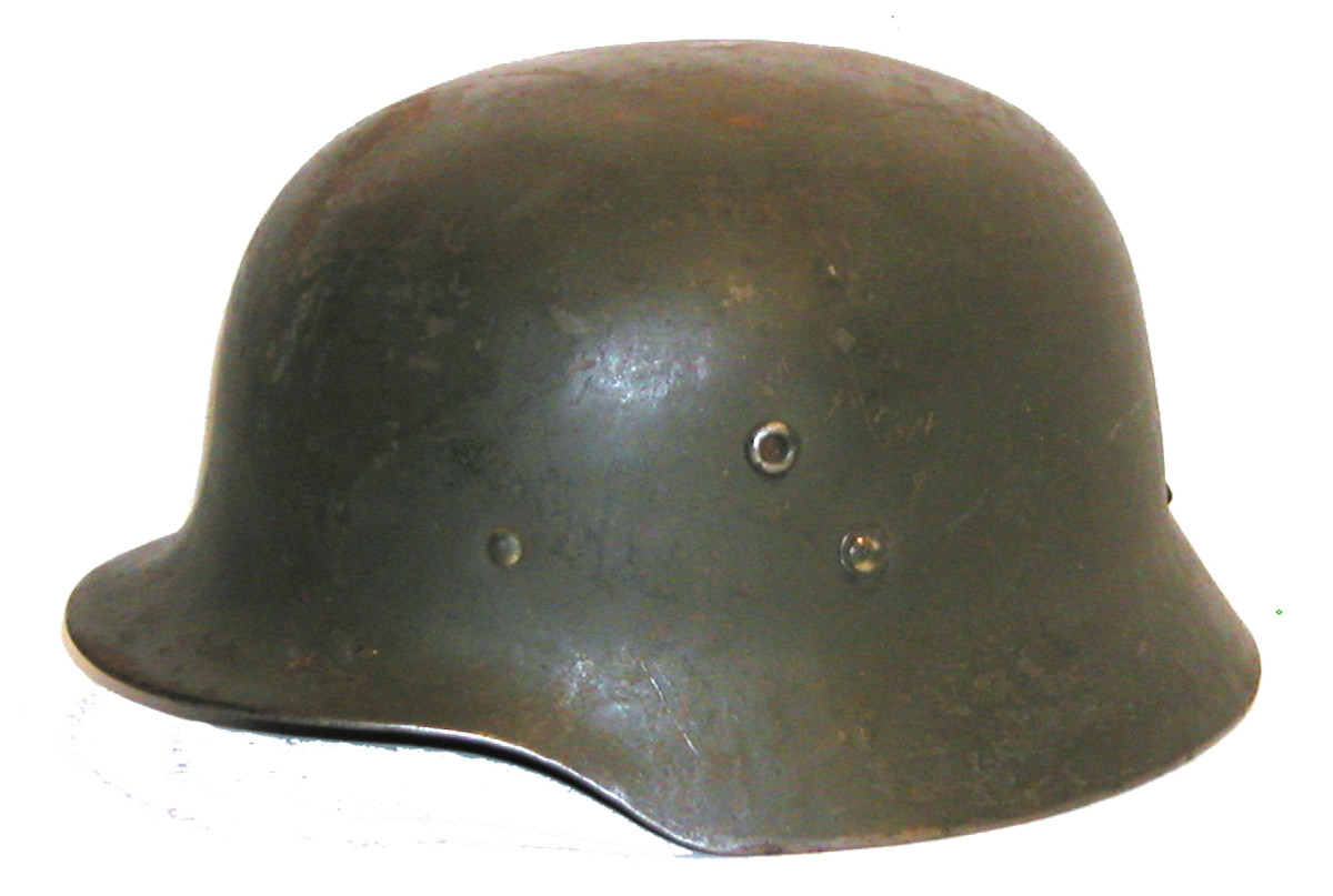 Finnish helmet of Hungarian origin. 75,000 helmets were produced and imported to Finland during the late 1930s before the Winter War with the Soviet Union. This particular helmet features a retrofitted Finnish liner and chinstrap was repainted for use by the Finnish army, likely post 1945.