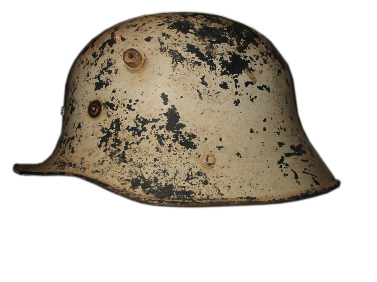 Irish Vickers helmet, or Model 1927. This helmet model was actually manufactured by the British Vickers Ltd. Company. This example features the remnants of the thick white paint that was applied for use a civil defense or auxiliary use.