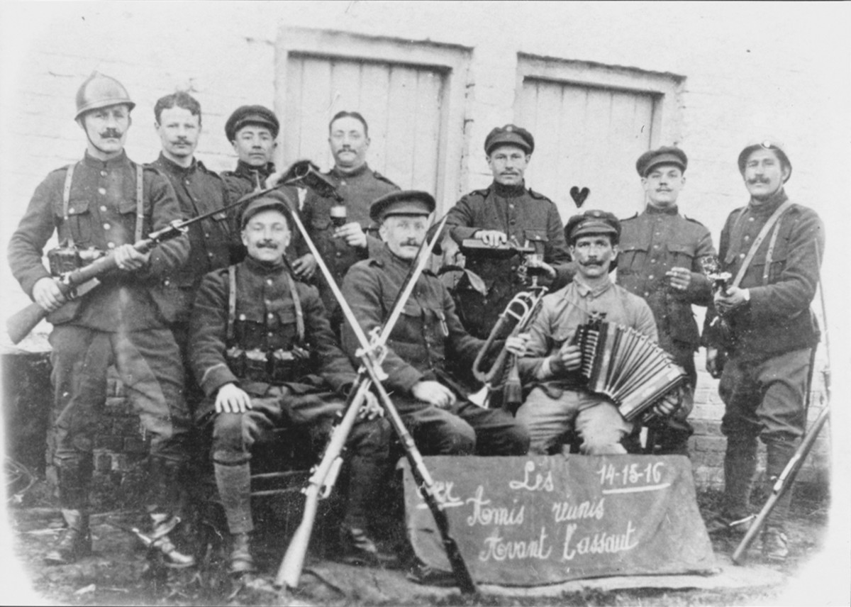 """Figure 8. This photo of a group of Belgian cavalry troopers in 1916 shows them """"Before the attack."""" They are wearing the khaki colored uniform and are armed with modified Model 1889 Mauser carbines """"allégée."""" Some of the carbines have had a French Model 1874 bayonet lug added so that the French Model 1874 Gras bayonet could be used."""