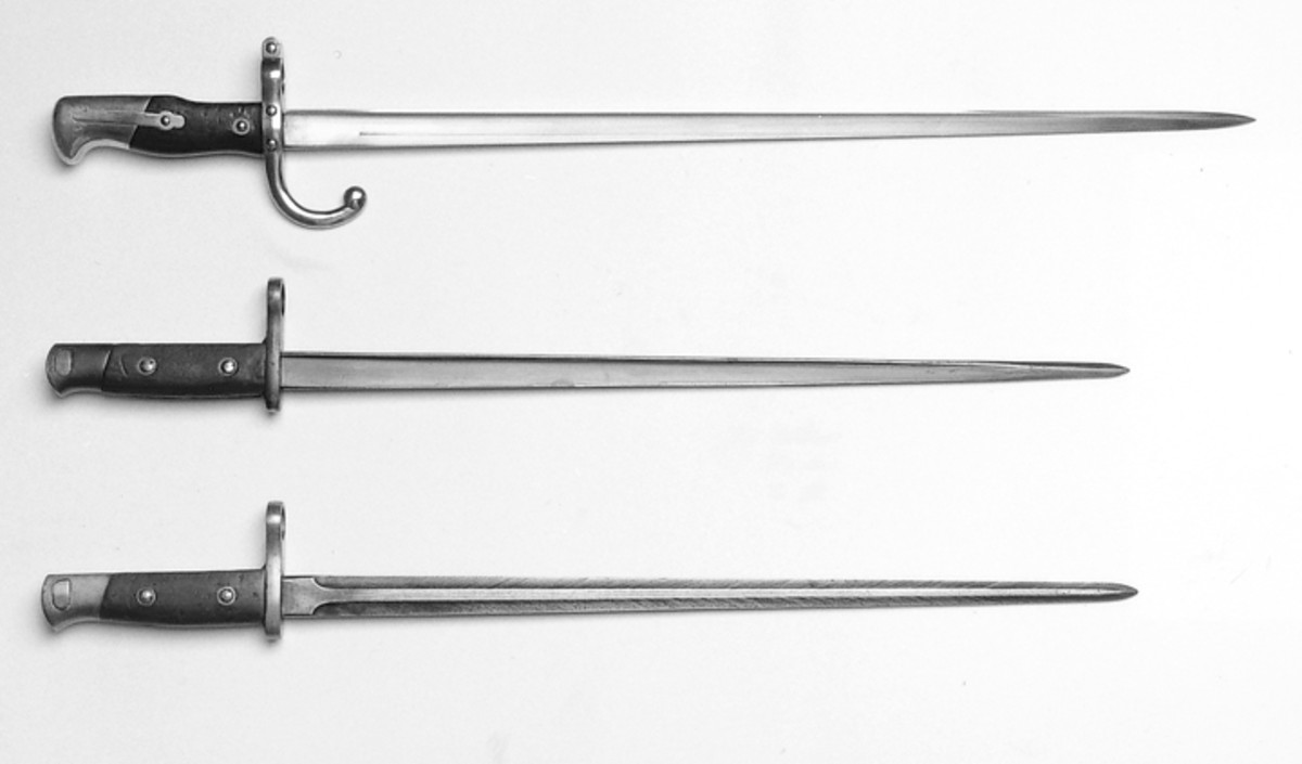From top to bottom is a French Model 1874 Gras bayonet, a Belgian Model 1916 Mauser bayonet with a recycled blade of a French Gras bayonet, and a Belgian Model 1916 Mauser bayonet. Note that the original length of the recycled blade of the French Gras bayonet was reduced to match the length of the blade of the Belgian Mauser bayonet.