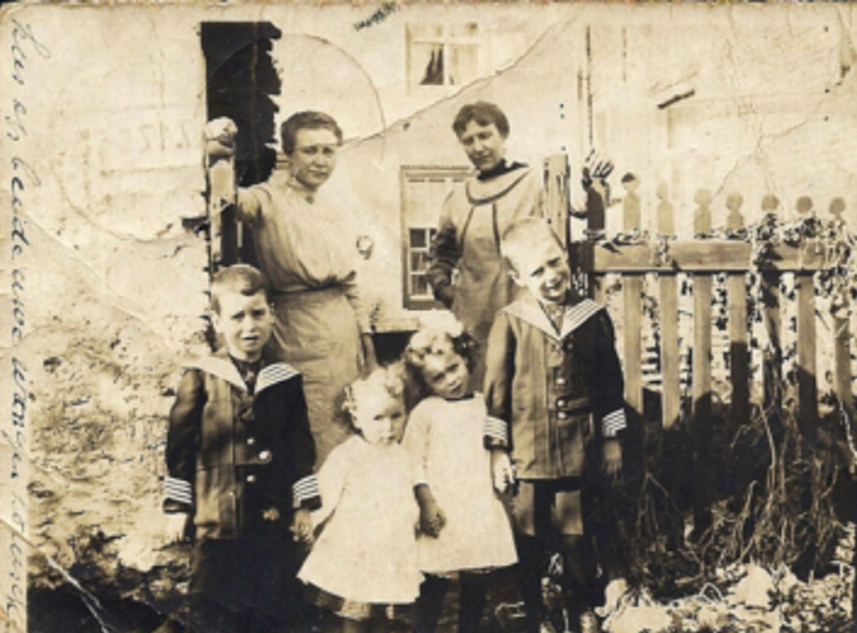 The Arthur Coninx family fled Belgium when the Germans invaded in August 1914. They walked in ditches and at night to reach Holland. This photo was taken while in exile. Robert Coninx, then about 5 or 6, is at the left.