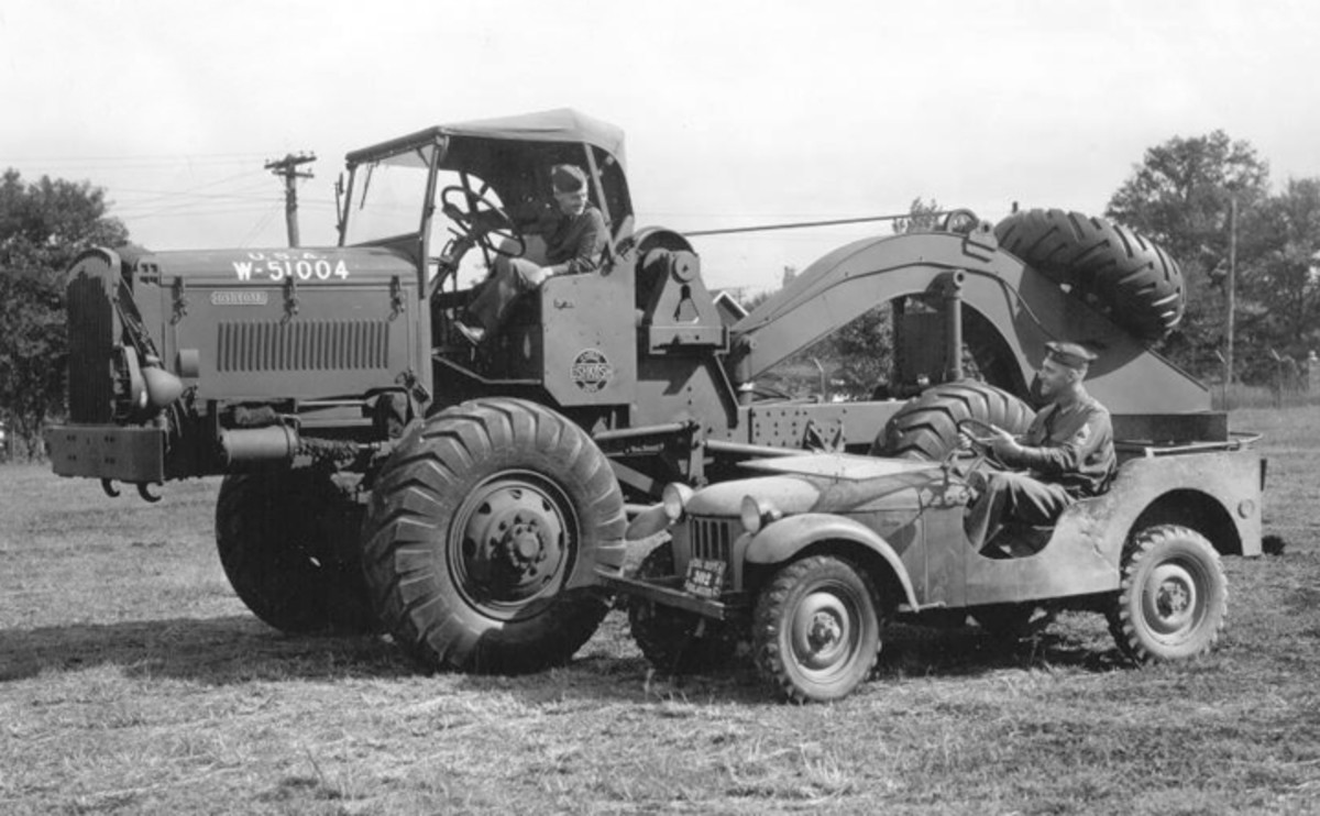 """The """"original"""" Jeep: the prototype Bantam Reconnaissance Car. Notice the scalloped cutouts for crew access and the curved fenders and separate protruding headlights without brush guards. All these features that eliminated when the first 75 pre-production units were built. The massive 4x4 beside it is a 5-ton prototype artillery tractor built by Oshkosh."""