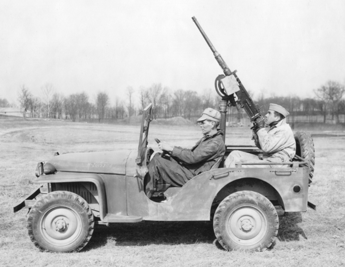 The 69 vehicles that were built on the pilot contract were known as the Bantam Model 60. This Model 60, outfitted with a machine gun, was photographed at Aberdeen Proving Grounds in March 1941. The scalloped doorway of the prototype has been replaced with a simpler opening, just as the elaborate fenders have been replaced with these simple flat versions.
