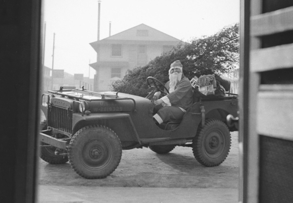 """The Jeep has been used in many roles, no doubt, far beyond the imaginations of the original engineers. Such adaptations of the Jeep have been prevalent since it was first fielded — such as this MA """"commandeered"""" by Santa for Christmas, 1941."""