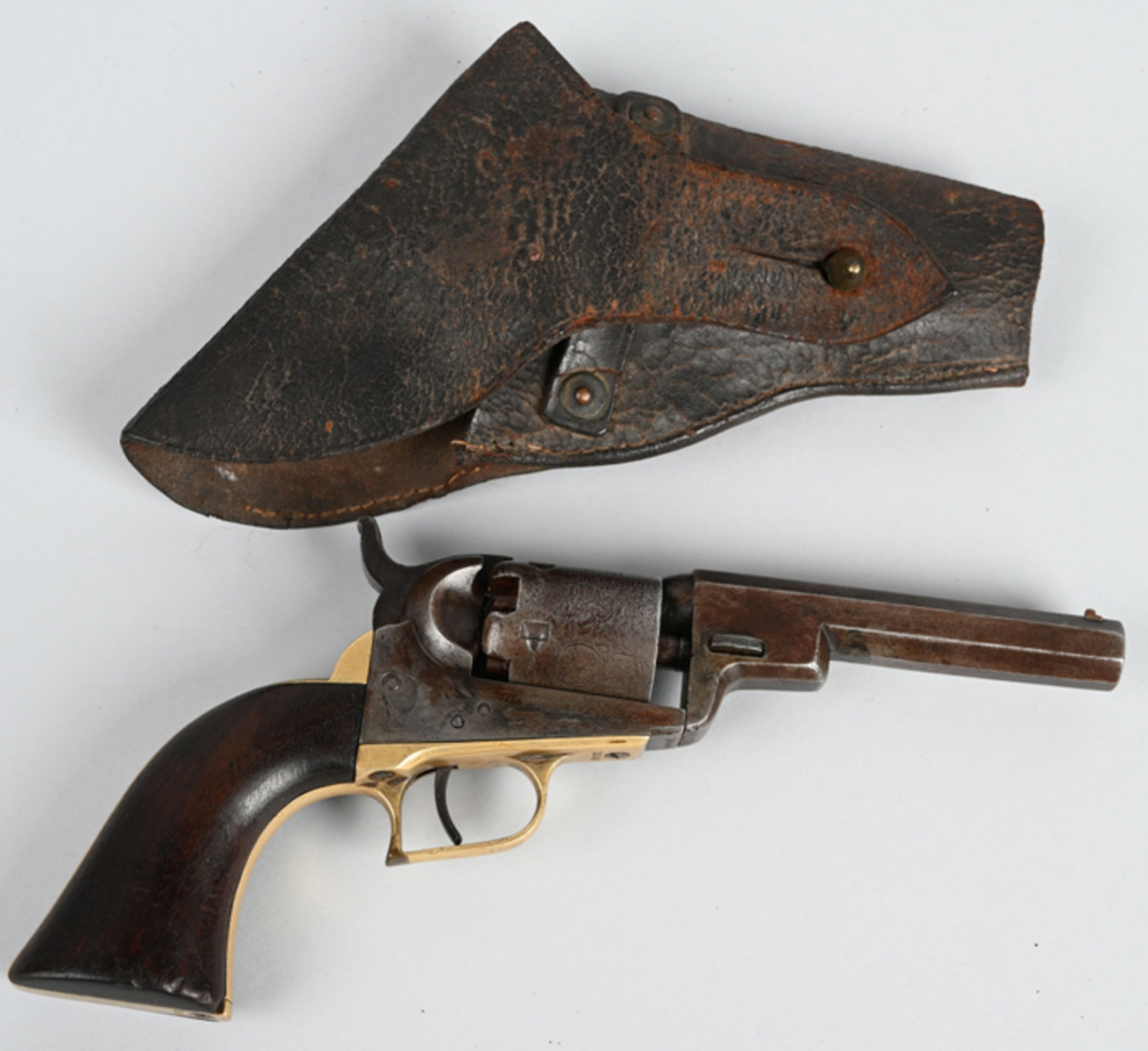 Rare 4-inch .31-caliber Wells Fargo Colt percussion revolver, made in 1857, cylinder scene of stagecoach.