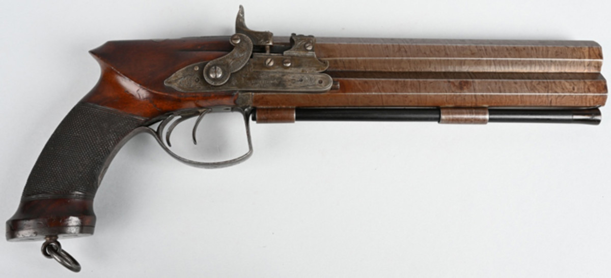 Mid-19th-century Forsyth & Co., London, .65-caliber self-priming double hammer over/under pistol with 9-inch Damascus twist-rifled full octagon barrels. Beautiful condition with fine English engraving.