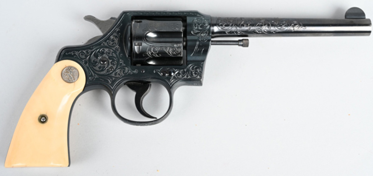 Colt Official Police Revolver, .38 Special, made in 1930, factory-engraved by Colt master engraver William H. Gough (active 1912-1940).