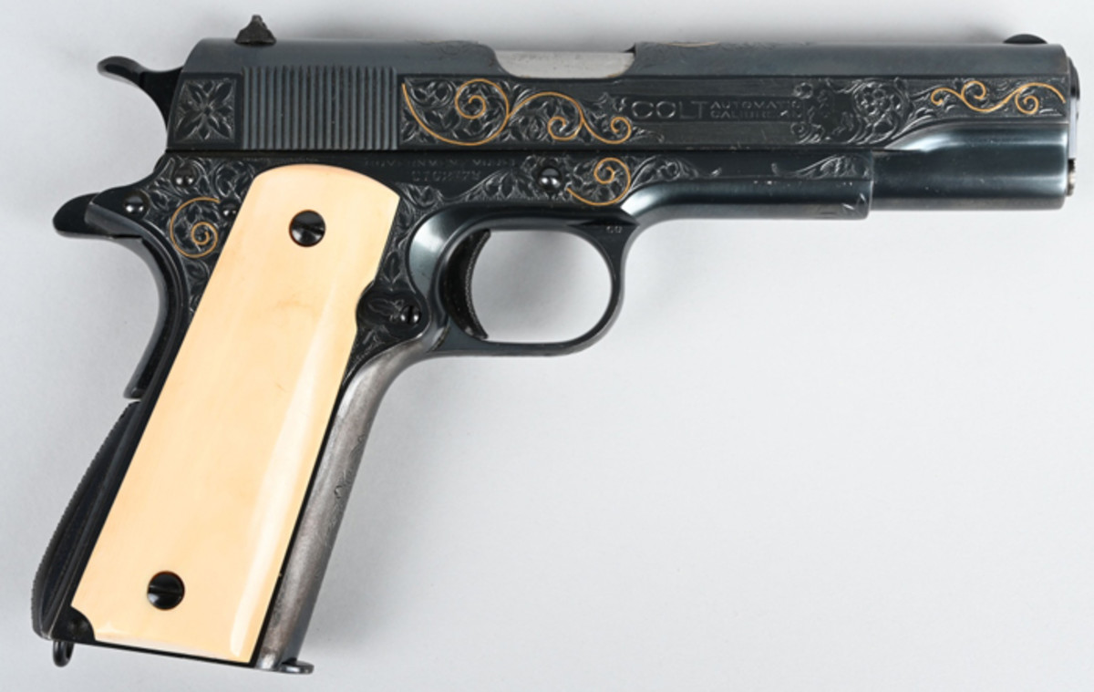 Gold-inlaid Colt 1911 .45 ACP-caliber gun, factory-engraved by Colt master engraver William H. Gough (active 1912-1940). Shipped in 1931 to Scruggs, Vendervoort & Barney, St. Louis.