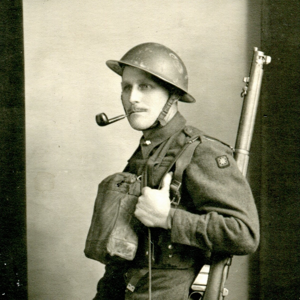 William Andrew, No. 2 Coy, No 3 Sec, Train. Section, 2nd Corps of Signals, wearing a MK II helmet.