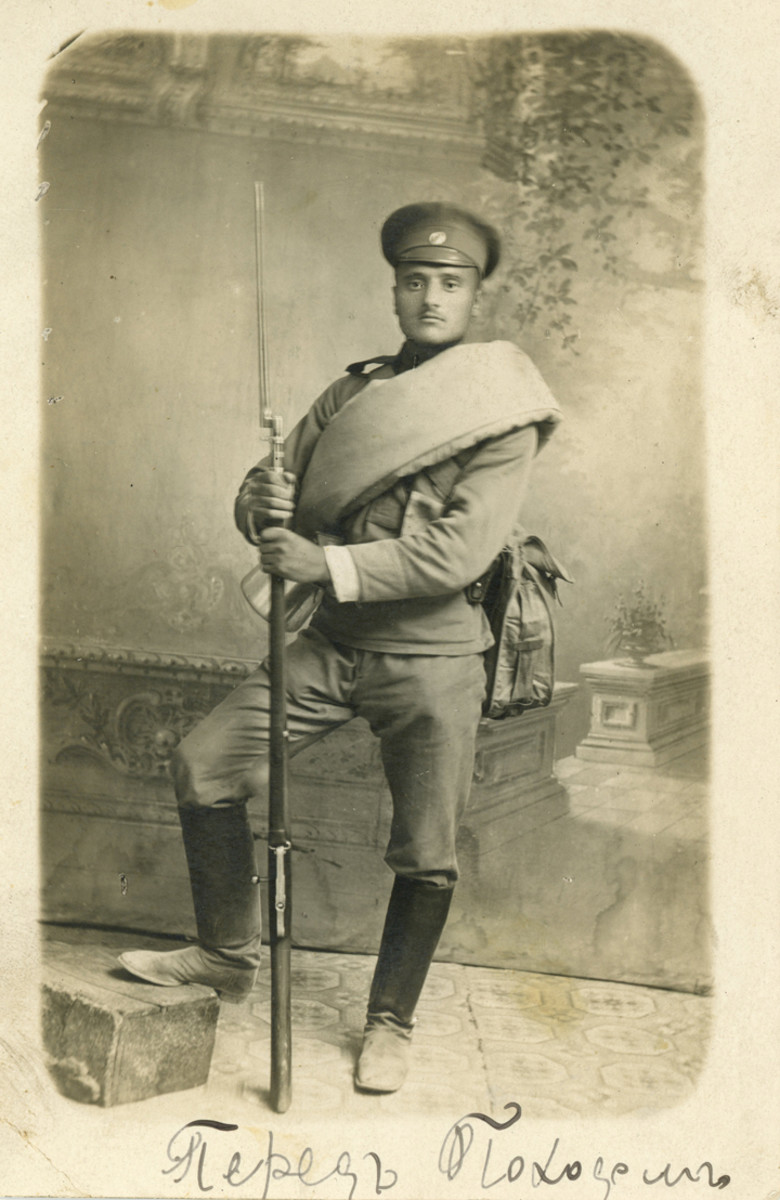 This Russian is typical of the Czar's infantry of pre-1917. He is wearing his blanket roll with the ends stuffed into his mess kit, and his Mosin-Nagant rifle.