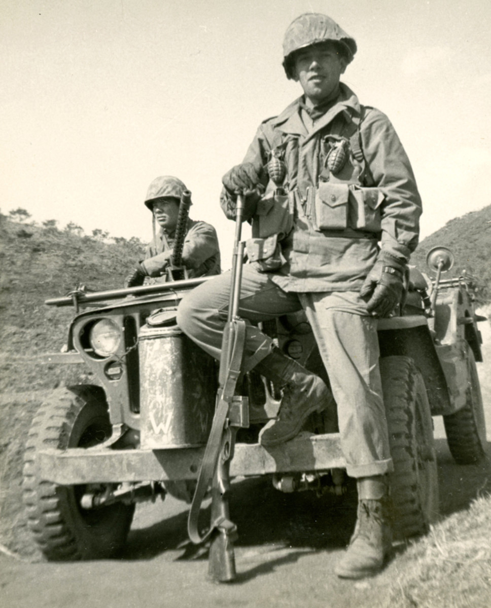 The BAR man is wearing leather gloves, a few grenades, and his helmet at a jaunty angle. The fellow in the Jeep behind him is looking away from the camera while leaning on a dash-mounted .30 caliber—an uncommon set up for a Jeep.