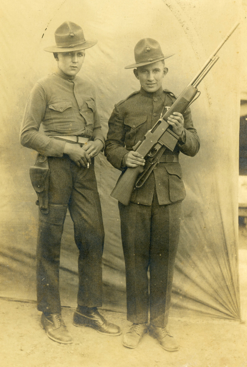 Unidentified, this photo embodies the spirit of the Corps after WWI. One of the Marines is wearing his pistol low, in a swivel holster while the other shows off his Browning Automatic Rifle.