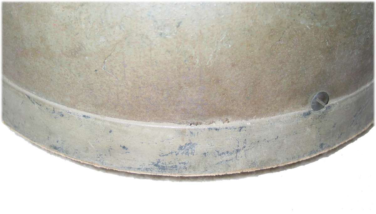 Close up look at the fiber rim of the British paratrooper helmet.