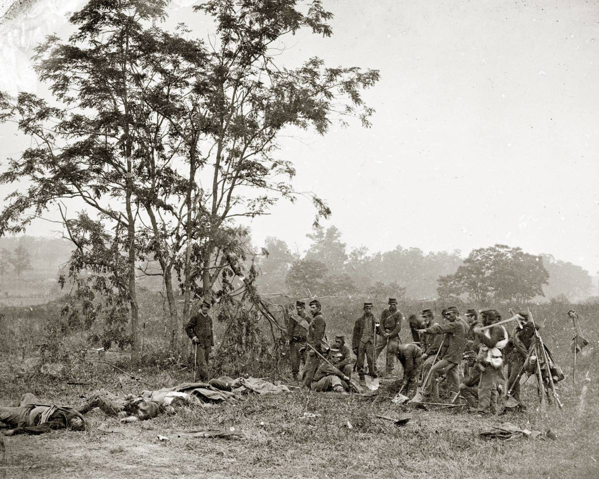 Following the one-day battle near Sharpsburg, Maryland, burial crews worked to cover thousands of dead Confederate and Union bodies. Alexander Gardner photographed this Burial crew of Union soldiers after the Battle of Antietam, in September 1862.