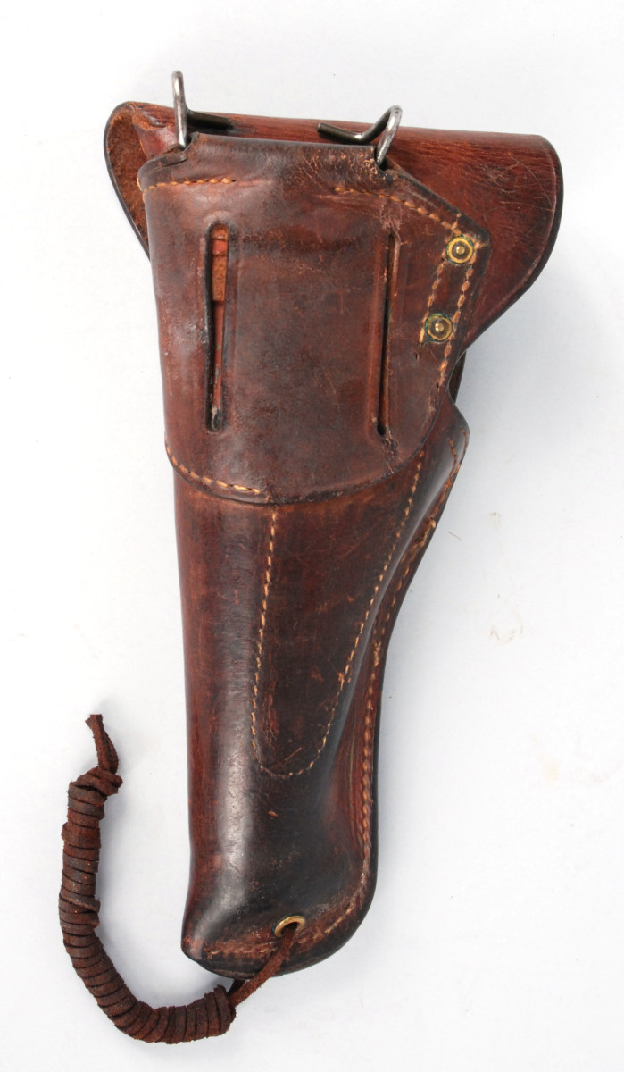 """During its """"active"""" life, a leather item acquires oils from handling. Sometimes, this is enough to turn the color from a reddish brown to almost black. This has been observed on several M1911 holsters, making them appear, at first glance, as if there were post World War II manufacture."""