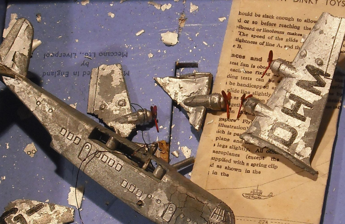The remains of a Dinky Toy model flying boat show the damage due to zinc pest.