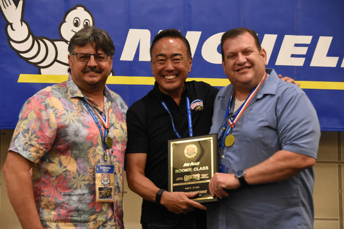 Driver Dominick Celia (left) and navigator, Michael Spina (right) receive their  5th Place, Rookie Class award from Coker Tires CEO, Wade Kawasaki. The team also received the event's Doc Fuson Trucking Award.