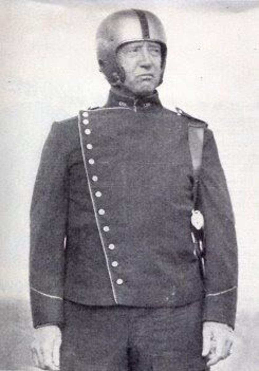 General George S. Patton, Jr.'s wearing his self-designed Tanker's uniform. While never adopted, elements, such as the boots, did influence the Army's design.