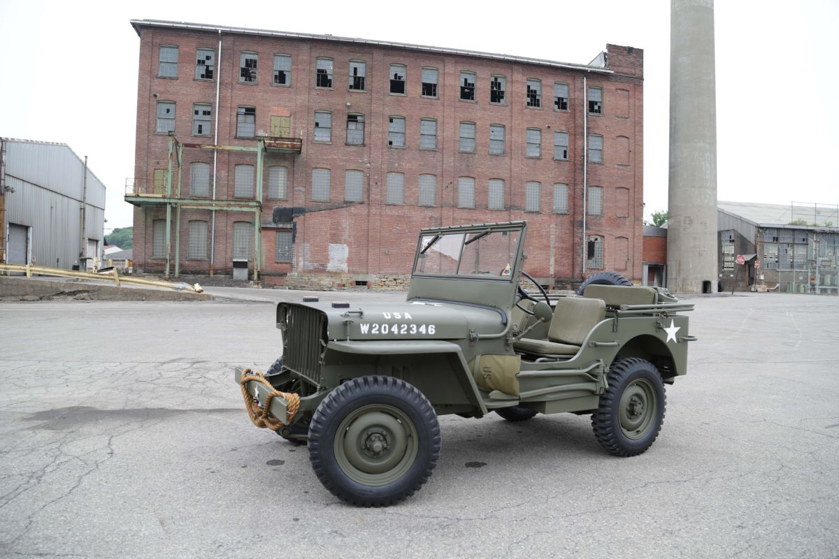 Richard Crotzer's 1942 Willys slat grille photographed in front of the last standing Bantam factory building Butler, Pennsylvania.