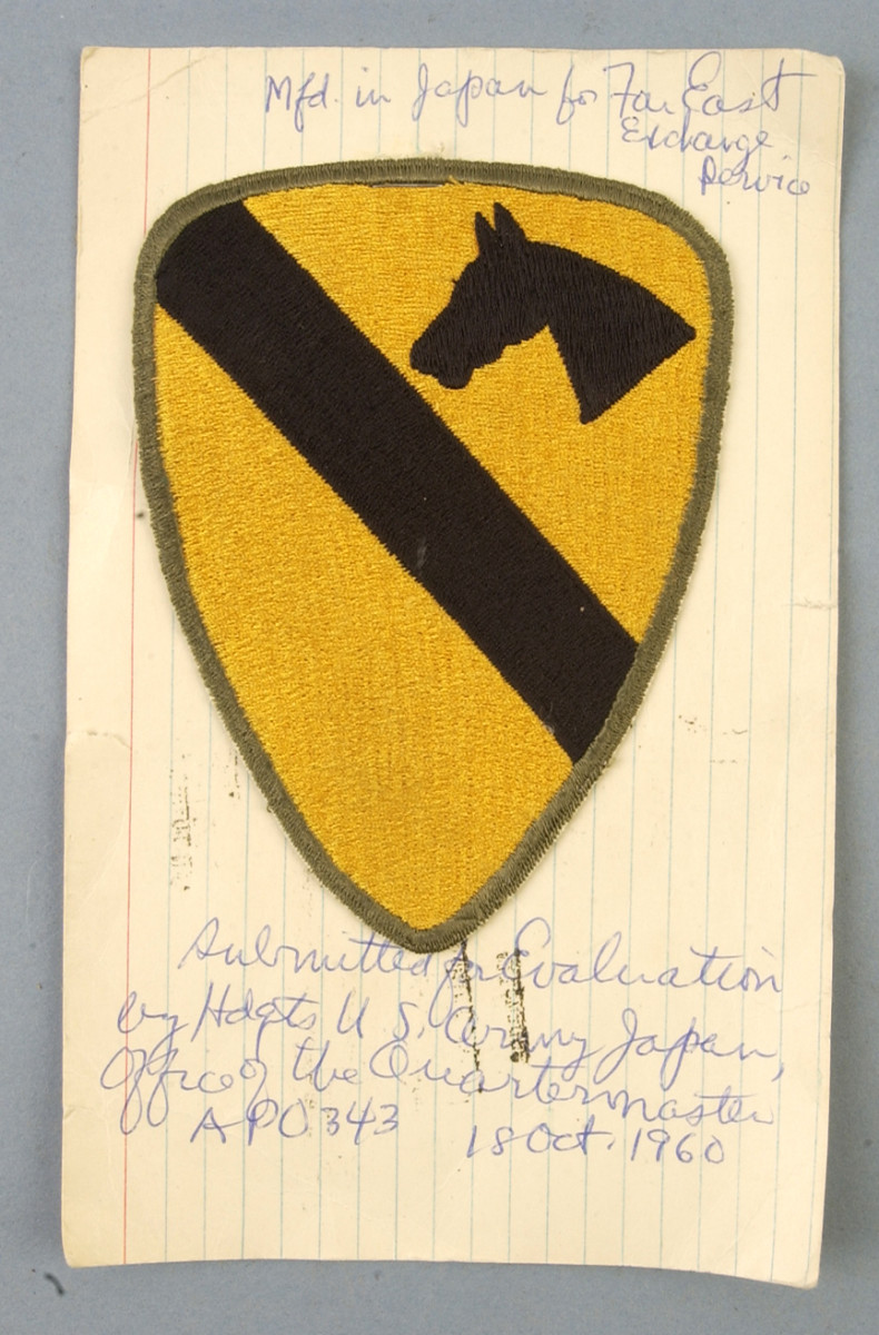 The cut-edge, olive drab-bordered 1st Division patch approved on October 18, 1960, came as a surprise to patch collectors who previously believed this style was discontinued a full three years earlier.