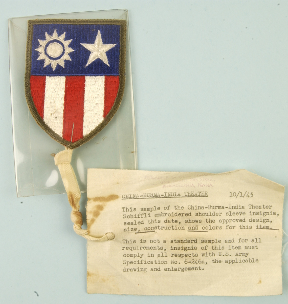 This OD-bordered China-Burma-India Theater insignia was Quartermaster-approved on January 10, 1945.
