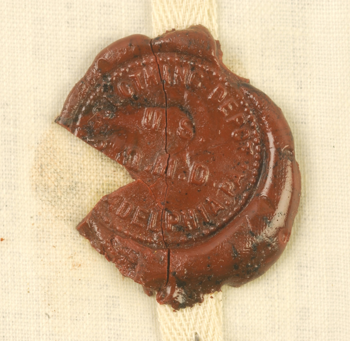 """Detail of the wax seal on the CBI patch reveals the logo of the """"Clothing Dept. U.S. Q.M.D. Philadelphia, Pa."""""""