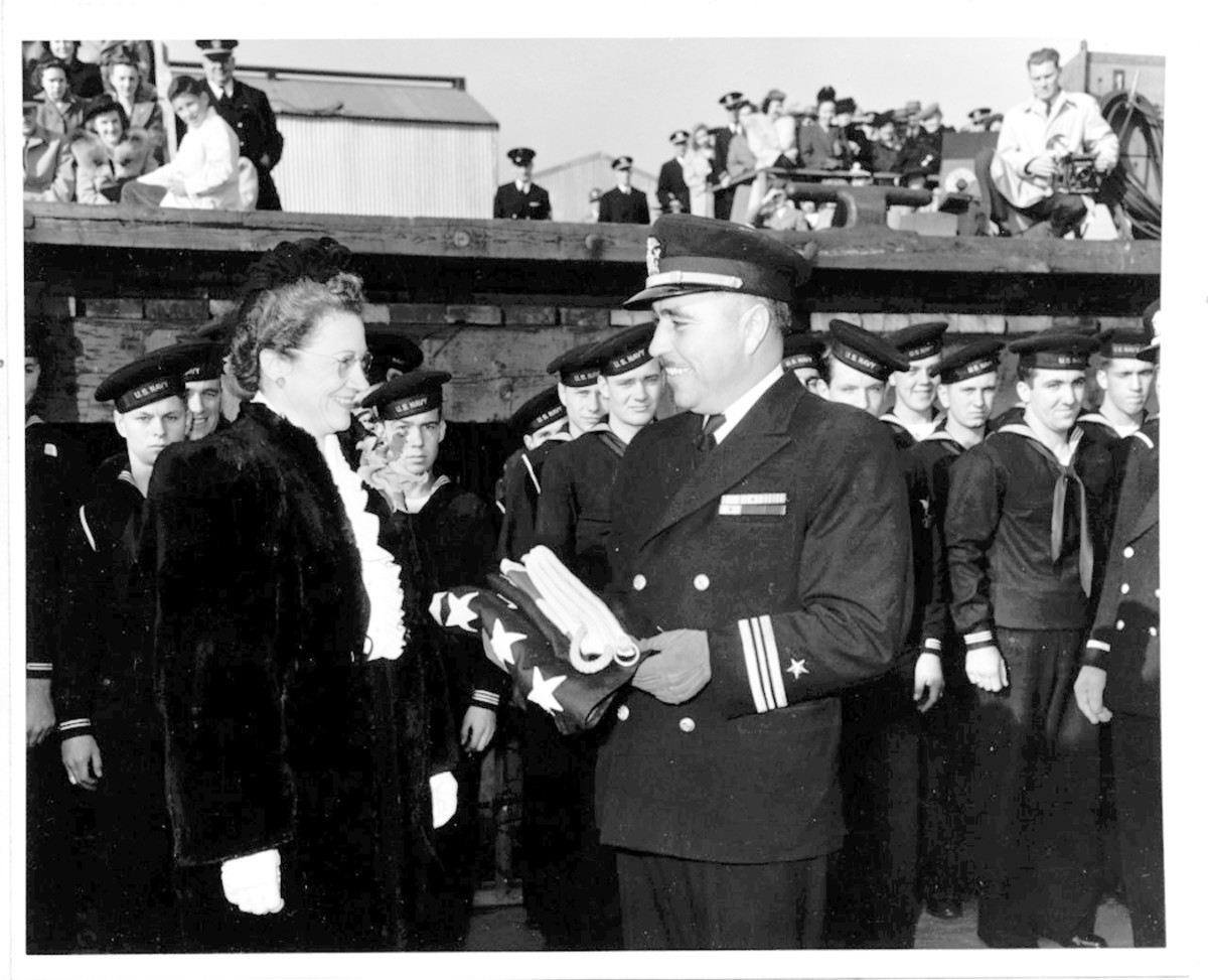 Lt. Cmdr. Ernest E. Evans, USN (1908-1944) at the commissioning ceremony for USS Johnston (DD-557), Seattle, Washington, 27 October 1943. He was Johnston's Commanding Officer from then until she was sunk in the Battle off Samar, 25 October 1944, and was lost with the ship.