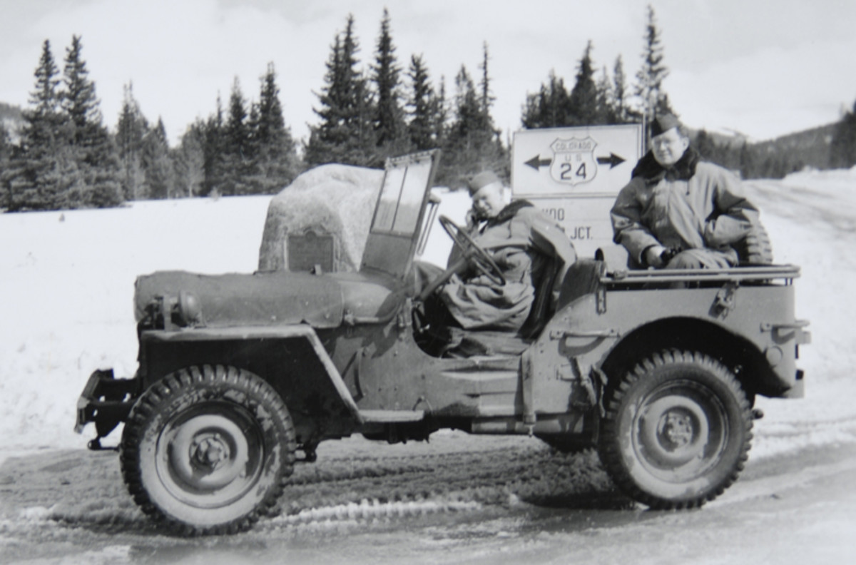 Sgt. Graf took this photo of his military police buddies while on patrol in the mountains above Camp Hale, Colorado. Note the full canvas hood cover on their Jeep.