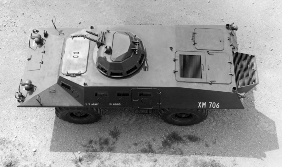 Characteristic of the XM706, this vehicle shows off its flat-topped driver's and commander's hatches, exposed engine grille, four vision blocks per side, and the lack of a side hatch into the engine compartment.