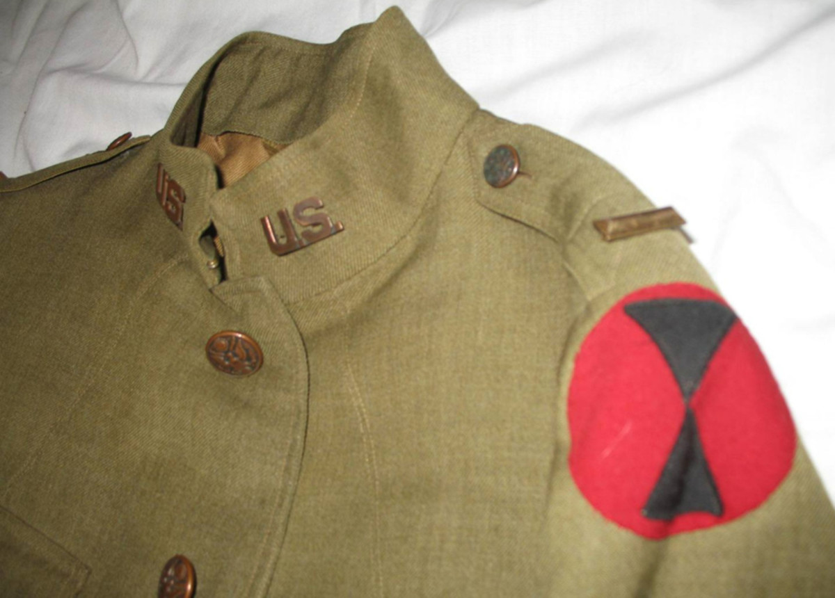 """LeMay's tunic features the """"coffin style"""" first lieutenant bars and a fine black-on-red, felt-on-felt """"hourglass"""" patch of the Seventh Infantry Division."""