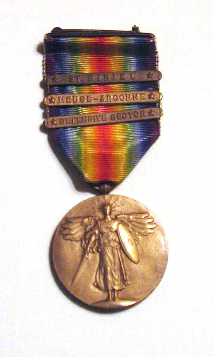 The WWI Victory Medal presented to Chaplain Arthur A. LeMay was found in the tunic's pocket. It has battle clasps for St. Mihiel, Meuse-Argonne (where LeMay was gassed) and Defensive Sector.