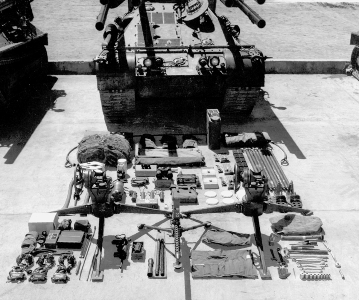 An array of On Vehicle Material, including two large tripods for dismounted use of two of the recoilless rifles. Between the tripods in this display is the M191A4 Browning .30 caliber machine gun. Though normally mounted on the turret at the commander's hatch, a tripod was also provided for its dismounted use as seen here.